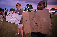 Protests against police brutality following the killing of Alton Sterling by police in Baton Rouge resume on Airline Highway across the street from the police station.