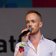 London, England, UK. 7th July 2018. Tom Knight make a speaks at the Pride parade in Trafalgar Square, London, UK on 7th July 2018.