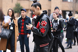 A model steps out the Fashion East Autumn / Winter 2017 London Fashion Week show at Tate Modern, London on Saturday February 18, 2017