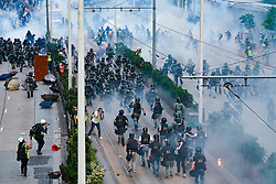 Hong Kong , 29th September, 2019. Riot police charge pro-democracy protestors through tear gas in Admiralty district of Hong Kong.