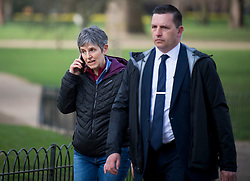 © Licensed to London News Pictures. 15/03/2021. London, UK. Commissioner of the Metropolitan Police CRESSIDA DICK is seen walking to New Scotland Yard in Westminster, London with her security. There have been calls for Met Chief Cressida Dick to resign following after police dragged women away from a bandstand at a vigil for murdered Sarah Everard in Clapham, South London. Photo credit: Ben Cawthra/LNP