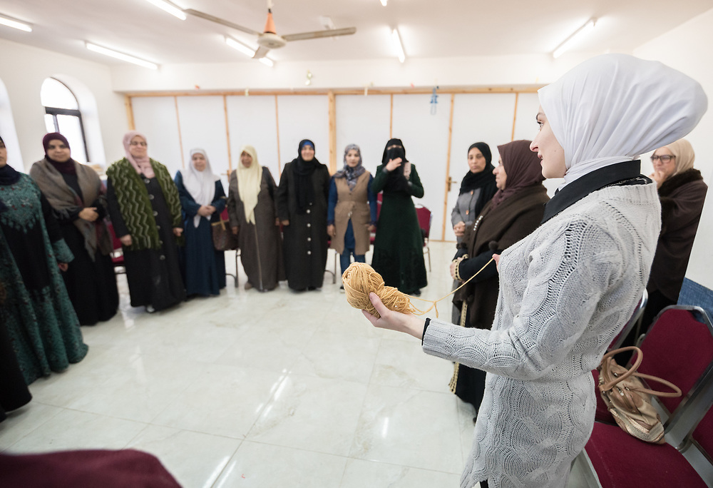 16 February 2020, Irbid, Jordan: Incentive-Based Volunteer Enas serves as caregiver facilitator during a caregiver support session led by the Lutheran World Federation at the Islamic Centre in Al-Mazar, offering psychosocial support to Syrian refugee mothers and Jordanian host communities.