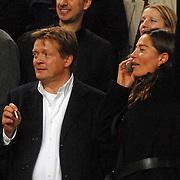 NLD/Amsterdam/20061115 - Voetbal, Nederland - Engeland, Sören Lerby rokend en partner Arlette van der Meulen