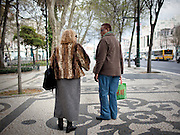 Two women talk in Avenida da Liberdade, in central Lisbon. This photograph is part of a body of work about Lisbon, feelings, affections and loneliness. Is about a city depressed by the crisis, but even so, tolerant and cosmopolitan. This part of Lisbon, with his deep character, where local people meets foreigners and alternative ways of life mixes with shamefaced poverty, is sublime by its peculiar light.