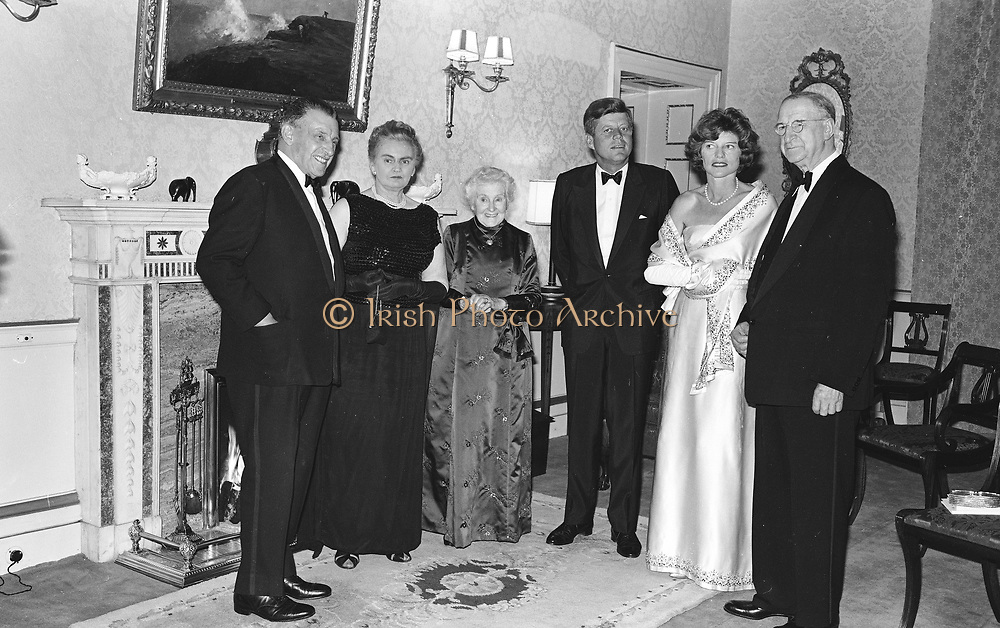 c333 5174<br /> 28.6.63<br /> President Kennedy entertained by President de Valera<br /> <br /> President Kennedy was to-night entertained at a dinner party given by the President of Ireland <br /> Mr. Eamon de Valera at aras an Uachearain, (the home of the Predsident) Phoenix Park, Dublin. Included in the group are (l-r) An Taoiseach (Premier) <br /> Sean Lemass and Mrs. Lemass, Mrs. de Valera wife of the President , President Kennedy,<br /> Mrs. Eunice Shriver and President de Valera. *** Local Caption *** It is important to note that under the COPYRIGHT AND RELATED RIGHTS ACT 2000 the copyright of these photographs are the property of Lensmen & Associates and they cannot be copied, scanned, reproduced or electronically stored in any form whatsoever without the written permission of Lensmen & Associates.