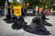 Oil Slick, black rebels demonstrate as part of the Extinction Rebellion 'Shell Out' protest on 8th September 2020 in London, United Kingdom. The environmental group gathered outside the Shell building to protest at the ongoing extraction of fossil fuels and the resulting environmental record. Extinction Rebellion is a climate change group started in 2018 and has gained a huge following of people committed to peaceful protests. These protests are highlighting that the government is not doing enough to avoid catastrophic climate change and to demand the government take radical action to save the planet.