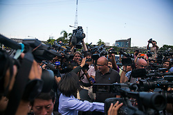 © Licensed to London News Pictures. 22/05/2014. The media surround a military spokesperson after political party leaders were kept under arrest during a meeting hosted by Thailand's army chief at the Army Club, between representatives from both sides of the country's political groups the PDRC & UDD at the conclusion of the meeting the Thailand army imposed a Military Coup, in Bangkok Thailand.  Photo credit : Asanka Brendon Ratnayake/LNP