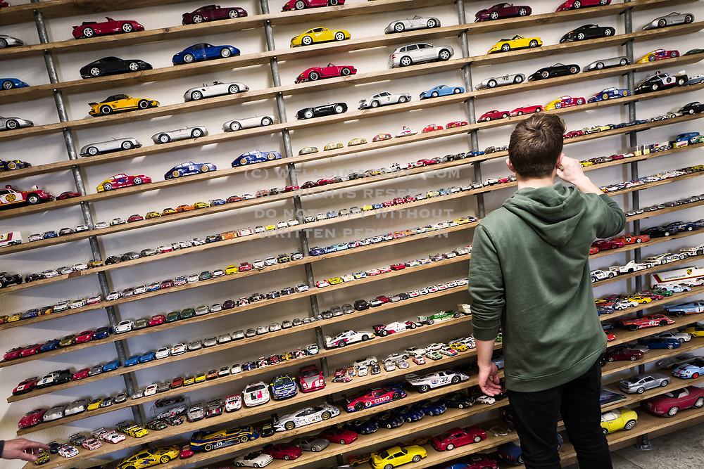 Image of Zayne Emory enjoying the toy car collection at Emory Motorsports, Hollywood, California, America west coast by Randy Wells