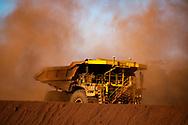Iron ore haulage trucks at a mine site in the Pilbara region of Western Australia.