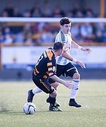 Hearts Callum Paterson pastAlloa Athletic's Mark Docherty.<br /> Alloa Athletic 0 v 1 Hearts, Scottish Championship played at Recreation Park, Alloa.