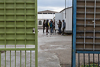 ATHENS, GREECE - FEBRUARY 05: Refugees wait for registration after arriving at the Eleonas refugee camp on February 05, 2015 in Athens, Greece. Hundreds of refugees are transferred every day to Eleonas refugee camp while waiting to travel to the Macedonian border. Photo: © Omar Havana. All Rights Are Reserved