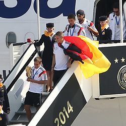15.07.2014, Flughafen Tegel, Berlin, GER, FIFA WM, Empfang der Weltmeister in Deutschland, Finale, im Bild Philipp Lahm (GER) mit dem WM-Pokal und Bastian Schweinsteiger (GER) mit Deutschlandfahne verlassen als Erstes das Flugzeug. // SPO during Celebration of Team Germany for Champion of the FIFA Worldcup Brazil 2014 at the Flughafen Tegel in Berlin, Germany on 2014/07/15. EXPA Pictures © 2014, PhotoCredit: EXPA/ Eibner-Pressefoto/ Hundt<br /> <br /> *****ATTENTION - OUT of GER*****