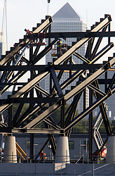 Stadium. Workers beside a steel raker on the second tier of the Stadium. Picture taken on 09 Oct 2008 by David Poultney.