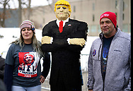 People pose with a likeness of U.S. President Donald Trump made out of 44,000 plastic blocks outside a Trump rally in Des Moines, Iowa, U.S., January 30, 2020. REUTERS/Rick Wilking