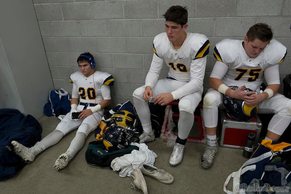 Oak Ridge Trojans get ready inside the locker room before the game as the Folsom High School Bulldogs varsity football team host the Oak Ridge High School Trojans,  Friday Nov 4, 2016.<br /> photo by Brian Baer