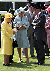 Her Majesty The Queen (left), The Duchess of Cornwall (centre) and Johnny Weatherby during day two of Royal Ascot at Ascot Racecourse.