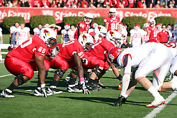 15 October 2011: Milton Owens. Keenan Wimbley and Cal McCarthyduring an NCAA football game between the University of South Dakota Coyotes and the Illinois State Redbirds (ISU) at Hancock Stadium in Normal Illinois.