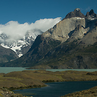 Lake Norenskjold stretches below the Horns of Paine and the Grand Tower of Paine (L) in Torres del Paine National Park, Chile.