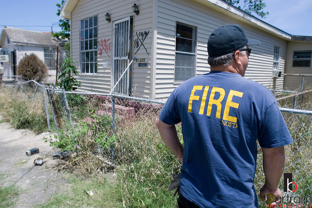 KEVIN BARTRAM/The Daily News.New Orleans firefighters help search homes damaged by flooding following Hurricane Katrina on Thursday, May 11, 2006, more than eight months after the hurricane. Each team searches about 50 houses each day in the city's Lower Ninth Ward.