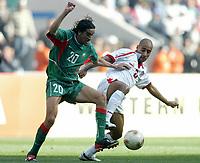 Fotball<br /> African Nations Cup 2004<br /> Afrika mesterskapet 2004<br /> Foto: Digitalsport<br /> NORWAY ONLY<br /> <br /> FINAL - 040214 <br /> TUNISIA v MOROCCO <br />  YOUSSOUF HADJI (MAR) / MEHDI NAFTI (TUN)  *** Local Caption *** 40001044