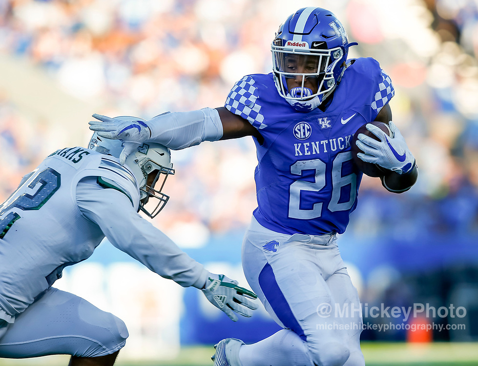 LEXINGTON, KY - SEPTEMBER 30: Benny Snell Jr. #26 of the Kentucky Wildcats runs the ball as Derric Williams #42 of the Eastern Michigan Eagles tries to make the stop at Commonwealth Stadium on September 30, 2017 in Lexington, Kentucky. (Photo by Michael Hickey/Getty Images) *** Local Caption *** Benny Snell Jr.; Derric Williams