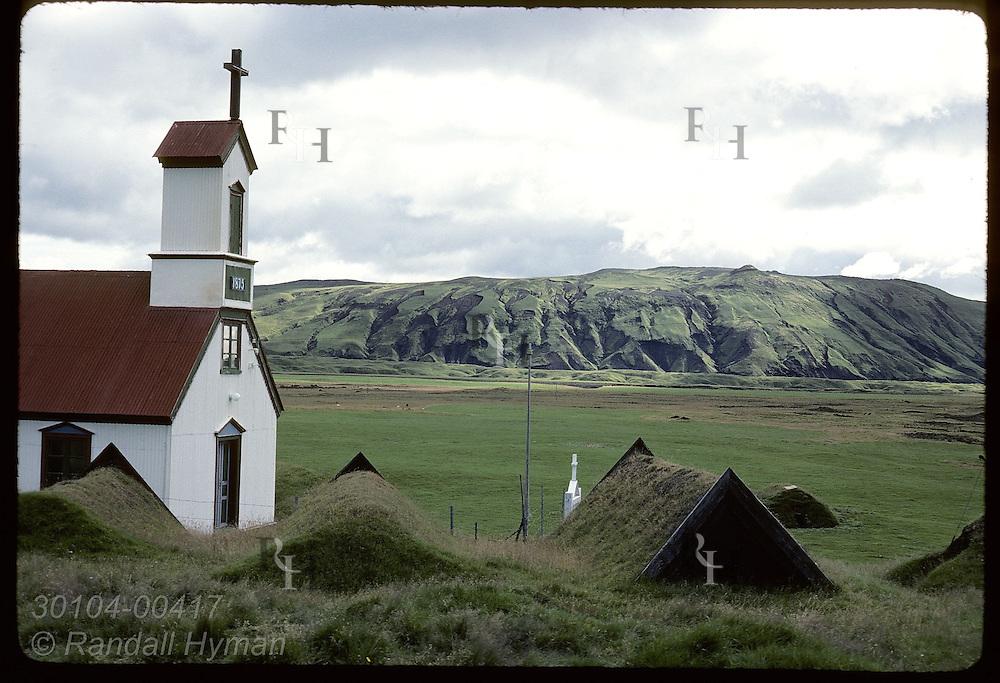 Keldur church sits beside row of sod farmhouses, among Iceland's oldest buildings. * Iceland