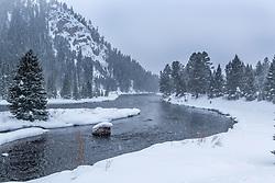 A snowstorm envelops the Madison River Narrows above Quake Lake near West Yellowstone Montana.