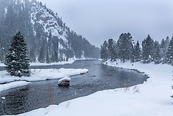 A snowstorm envelops the Madison River Narrows above Quake Lake near West Yellowstone Montana.