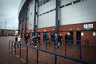 Fans queueing to enter Hampden Park, Glasgow, prior to Queen's Park's fixture against Alloa Athletic in a Scottish League second division match. The home team won by one goal to nil with a goal by Alan Trouten in the 88th minute. Queen's Park, founded in1867, are currently trying to become only the third FIFA Order of Merit club after Real Madrid and Sheffield FC.
