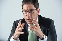 12 MAY 2010, BERLIN/GERMANY:<br /> Dr. Nedim Cen, Vorstandsvorsitzender Q-Cells, waehrend einem Interview, Buero von QCI<br /> IMAGE: 20100512-01-008