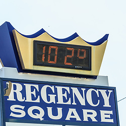 Lancaster, PA, USA - July 19, 2013: Outdoor thermoter displaying 102 degree temperature.