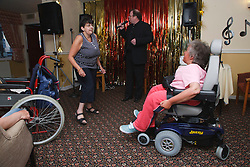 People with disabilities enjoy dancing on holiday in Blackpool.