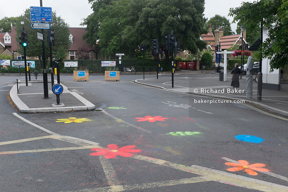 The pedestrianised road junction at Carlton Avenue, Court Lane and Dulwich Village, has been blocked off to passing traffic with plant boxes at the corner as part of emergency Coronavirus pandemic policy to keep pedestrians safe at the expense of traffic, the first phase in an experimental road layout, on 30th June 2020, in London, England. Southwark was awarded £1.3 million by TfL from its Streetspace funding pot, which aims to rapidly transform London's streets to help facilitate social distancing, cycling, and walking as lockdown eases. Dulwich Village low traffic neighbourhood was granted £23,000 for the first phase and £110,000 for the second. As part of its 'our healthy streets' initiative, the council had already earmarked the Village as an LTN.