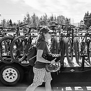 Heather Goodrich and a group of mountain bikers load their bikes onto a Teton Pass shuttle during Freedomriders.org Pass Bash fund raising day.