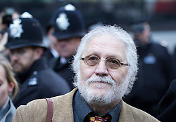 © Licensed to London News Pictures. 14/01/2014. London, UK. Former Radio One presenter Dave Lee Travis, real name David Patrick Griffin, arrives at Southwark Crown Court in London today (14/01/2014). Travis is appearing in court, after being arrested at his home by the Metropolitan Police as part of Operation Yewtree, due to alleged sexual assaults during the 1970's and 80's during his time at the BBC  Photo credit: Matt Cetti-Roberts/LNP