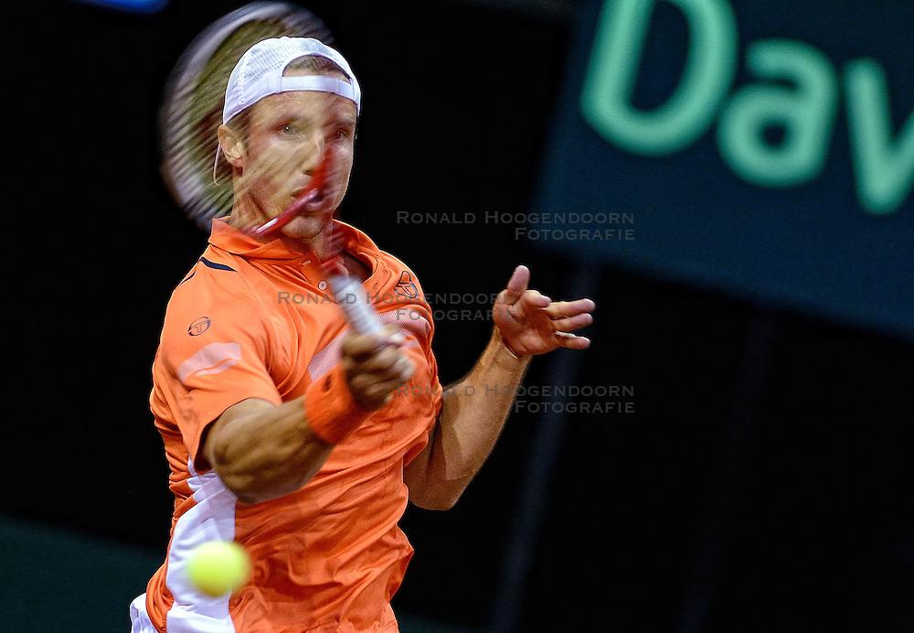 12-09-2014 NED: Davis Cup Nederland - Kroatie, Amsterdam<br /> Igor Sijsling in de actie tijdens de eerste wedstrijd van de vijf.