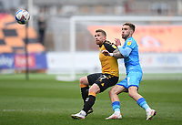 Football - 2020 / 2021 Sky Bet League Two - Newport County  vs Cheltenham Town - Rodney Parade<br /> <br /> Scot Bennett of Newport County holds off the challenge from Sam Smith of Cheltenham Town .<br /> <br /> COLORSPORT/ASHLEY WESTERN