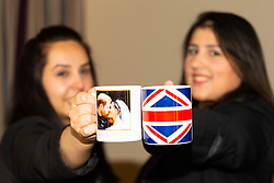 Deputy Hotel Manager Nicky Gashtasbi and Assistant Manager Bruna Salvadori pose with two mugs left in one of the hotel's rooms. London, July 24 2019.