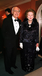 SIR DENIS THATCHER and his wife BARONESS THATCHER the former Prime Minister,  at a dinner in London on 29th February 2000.OBS 47