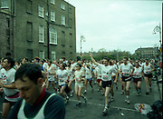 Dublin City Marathon.  (R90)..1988..31.10.1988..10.31.1988..31st October 1988..The 9th running of the annual Dublin City Marathon took place in Dublin today. This years event was sponsored by Mars. The mens race was won by John Griffin, Ireland and the ladies race was won by Moira O'Neill, Great Britain. Many hundreds of fun runners take part in this race and they generate millions for the many charities which seek help at this time...A view of the runners in the Dublin City Marathon wearing shirts representing some of the many charities which benefit from the sponsorship gathered by the runners.
