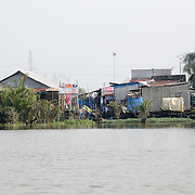 Makeshift houses on the banks of the Saigon River in Ho Chi Minh City, Vietnam.