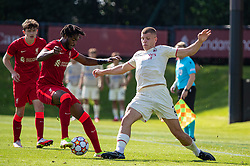 LIVERPOOL, ENGLAND - Wednesday, September 15, 2021: Liverpool's James Balagizi (L) and AC Milan's Milos Kerkez during the UEFA Youth League Group B Matchday 1 game between Liverpool FC Under19's and AC Milan Under 19's at the Liverpool Academy. Liverpool won 1-0. (Pic by David Rawcliffe/Propaganda)