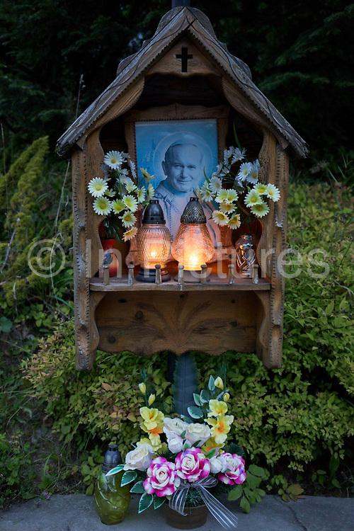 Candles burn in a shrine to Polish-born Pope John Paul II, on 16th September 2019, in Koscielisko, Zakopane, Malopolska, Poland. Jan Pawel II; born Karol Jozef Wojtyla 1920-2005 was head of the Catholic Church and sovereign of the Vatican City State from 1978 to 2005.
