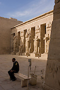Guards await tourists near Ramessid columns in the peristyle court at the ancient Egyptian site of Medinet Habu (1194-1163BC), the Mortuary Temple of Ramesses III in Luxor, Nile Valley, Egypt. Medinet Habu is an important New Kingdom period structure in the West Bank of Luxor in Egypt. Aside from its size and architectural and artistic importance, the temple is probably best known as the source of inscribed reliefs depicting the advent and defeat of the Sea Peoples during the reign of Ramesses III. According to the country's Ministery of Tourism, European visitors to Egypt  is down by up to 80% in 2016 after the suspension of flights after the downing of the Russian airliner in Oct 2015. Euro-tourism accounts for 27% of the total flow and in total, tourism accounts for 11.3% of Egypt's GDP.
