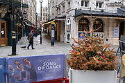 With the threat of job losses and huge revenue losses but inaccordance to the governments Covid social distance restrictions, a dead Christmas tree still remains near the Noel Coward Theatre as entertainment venues stay closed during the third lockdown of the Coronavirus pandemic, on 3rd February 2021, in London, England.
