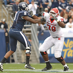 Oct 31, 2009; East Hartford, CT, USA; Rutgers offensive lineman Kevin Haslam (78) blocks Connecticut defensive end Lindsey Witten (9) during second half Big East NCAA football action in Rutgers' 28-24 victory over Connecticut at Rentschler Field.