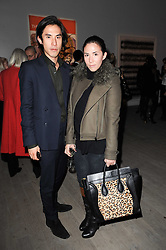 EDWARD TANG and his sister VICTORIA TANG at the Polo Jeans Co. hosted Art Stars Auction in support of the Teenage Cancer Trust held at Phillips de Pury & Co, Howick Place, London on 6th December 2010.