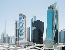 Modern high-rise office towers under construction at Business Bay in Dubai United Arab Emirates