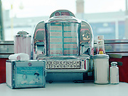 A miniature jukebox with condiments at an American themed diner on the 30th July 2011 in Belfast in the United Kingdom.