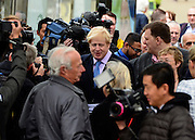 © Licensed to London News Pictures. 14/05/2013. London, UK The Mayor of London, Boris Johnson, leads a short walkabout around Wimbledon High Street to meet local people as he helps launch a public consultation on proposed routes for Crossrail 2. Today 14th May 2013. Photo credit : Stephen Simpson/LNP